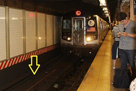 (图7)这种月台,画了红白双色条纹的那一面,是禁止过去的,下面有带高压电的第3条铁轨,一碰到就完。(蔡溶/大纪元)