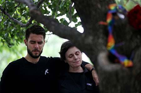 NEW YORK, NY - JUNE 16: People embrace after tying ribbons on the Survivor Tree at the National September 11 Memorial & Museum in honor of the victims of the Orlando nightclub attack on June 16, 2016 in New York City. Hundreds of people tied colored ribbons on the Survivor Tree at the National September 11 Memorial & Museum to honor the victims of the terror attack at the Pulse nightclub in Orlando over the weekend that left 49 dead. (Photo by Justin Sullivan/Getty Images)