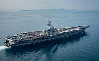 最近备受关注的美国卡尔文森号航母正在日本南部和日本空军自卫队一起联合军演。(Photo by Mass Communication Specialist 2nd Class Sean M. Castellano / U.S. Navy via Getty Images)