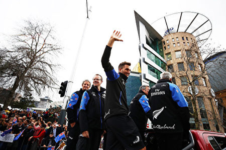 AUCKLAND, NEW ZEALAND - JULY 06: Blair Tuke of Team New Zealand thanks the crowd during the Team New Zealand Americas Cup Welcome Home Parade on July 6, 2017 in Auckland, New Zealand. (Photo by Hannah Peters/Getty Images)
