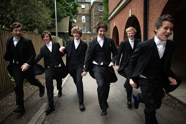 WINDSOR, UNITED KINGDOM - MAY 2008: Pupils of Wootton House make their way back from lessons at the iconic private school near Windsor, England. Eton College was founded in 1440 by King Henry VI. The College originally had 70 King's Scholars or 'Collegers' who lived in the College and were educated free, and a small number of 'Oppidans' who lived in the town of Eton and paid for their education. Eton has a very long list of distinguished former pupils, including eighteen former British Prime Ministers. (Photo by Christopher Furlong/Getty Images)