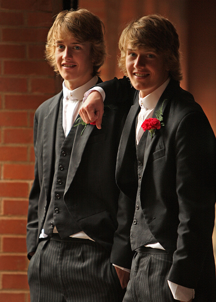 WINDSOR, UNITED KINGDOM - JUNE 2008: Pupils from Wootton House pose with flowers in their button holes, a traditional part of the annual June 4th celebrations, at the iconic private school near Windsor, England. The annual celebrations mark the start of the Summer half-term break, and traditionally showcase the variety of activities undertaken at the school as well as being a prominent date in the summer social season in England. The traditional day of celebration of June 4th is also the birthday of King George III. In addition to the historic procession of boats, where pupils dress in tradition naval attire and decorate their hats with flowers, speeches and displays are put on for parents and visitors. Eton College was founded in 1440 by King Henry VI. The College originally had 70 King's Scholars or 'Collegers' who lived in the College and were educated free, and a small number of 'Oppidans' who lived in the town of Eton and paid for their education. Eton has a very long list of distinguished former pupils, including eighteen former British Prime Ministers. (Photo by Christopher Furlong/Getty Images)
